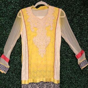 Light yellow 3 pieces Salwar kameez.